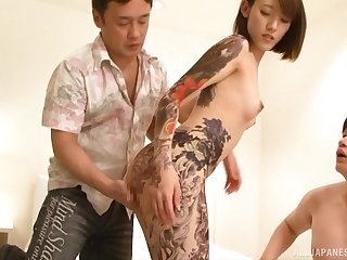 Asian babes sexy tattoos covered with cum in a MMF threesome
